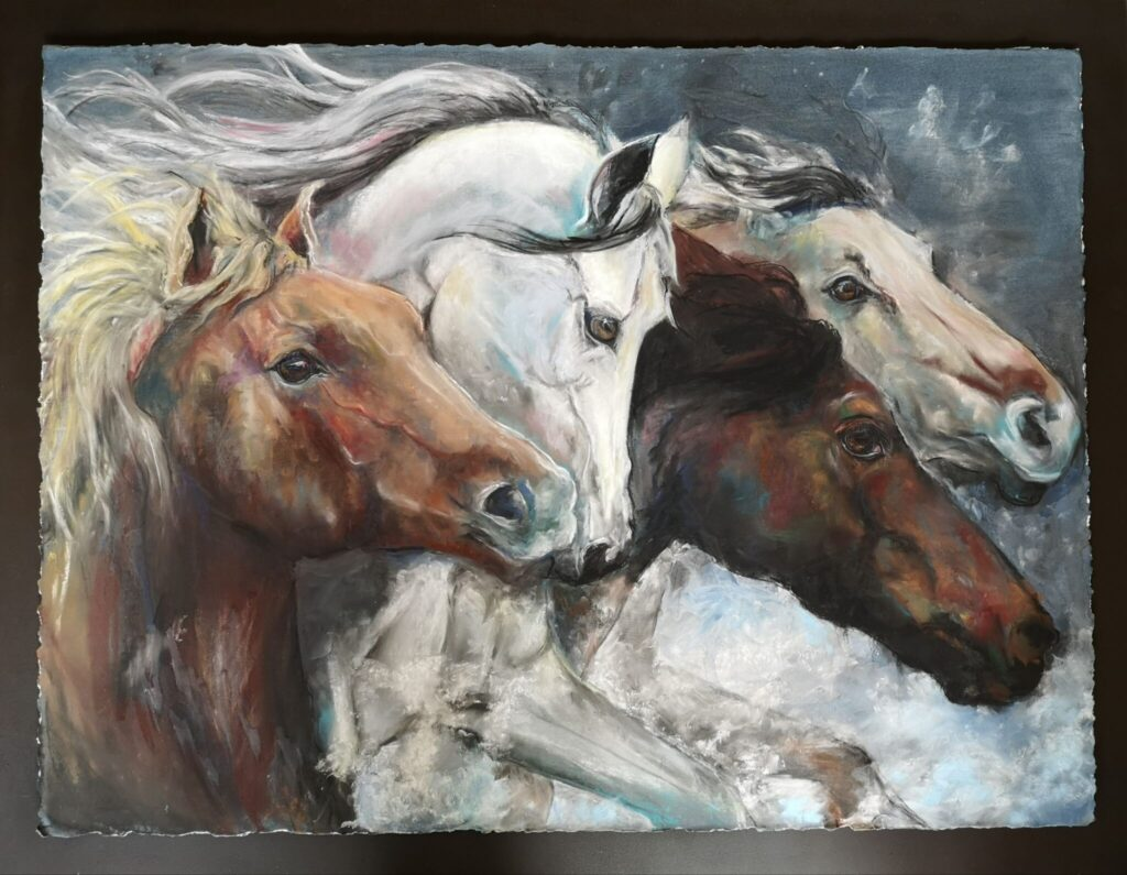 Pastel drawing of  wild horses running, floated and framed